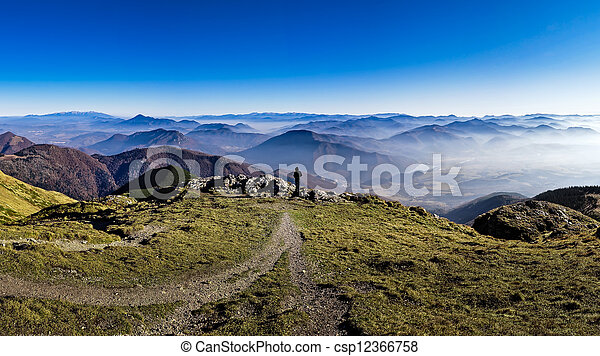 Silhouette of a man overlooking misty mountains - csp12366758