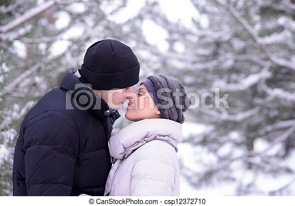 Portrait of a Young Beautiful Couple Kissing Outdoors in Winter - csp12372710