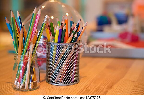 Pencils placed at glass and plastic can - csp12375976