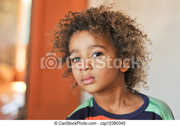 Stock Photo Of Young Mixed Race Boy With Curly Hair