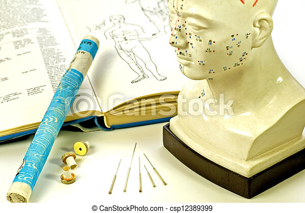 Acupuncture needles, head model, textbook and moxa roll - csp12389399