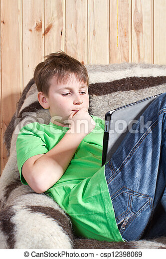 boy teenager with tablet computer - csp12398069