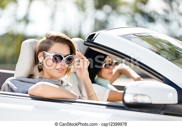 Close up view of girls in sunglasses in the automobile - csp12399978