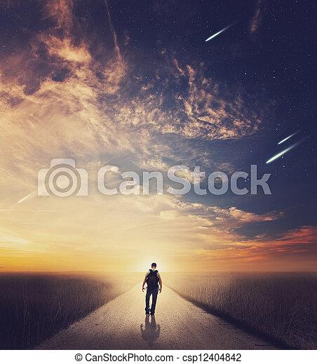 Man walking at sunset - csp12404842