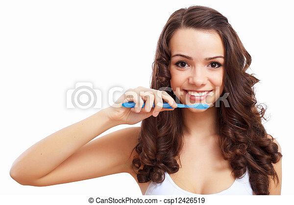 Young woman at home brushing teeth - csp12426519