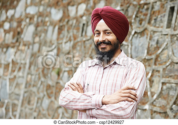 Young adult indian sikh man - csp12429927