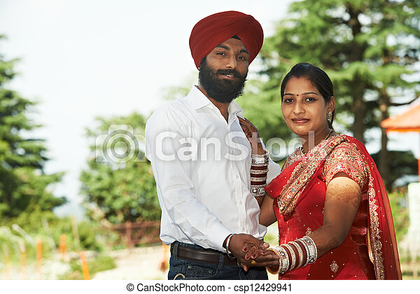 Happy indian young adult married couple - csp12429941