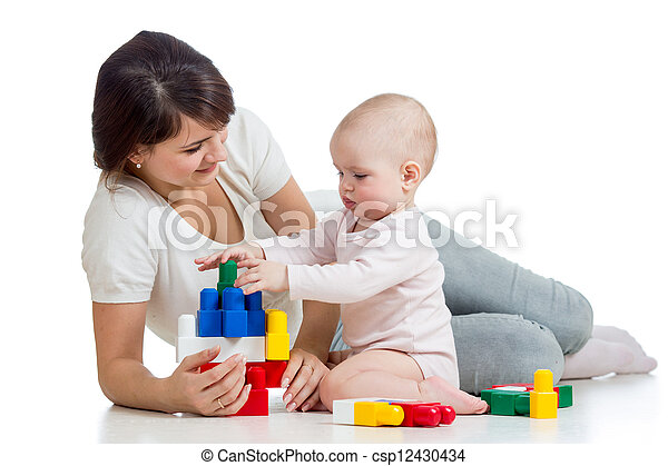 baby girl and mother playing together with construction set toy - csp12430434