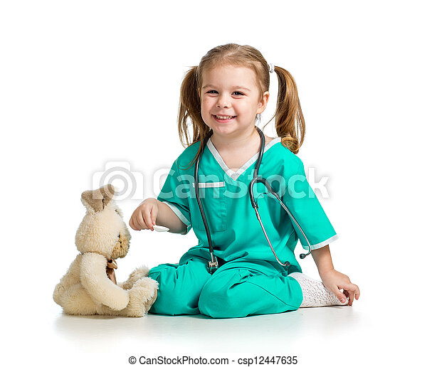 Adorable girl with clothes of doctor playing with toy over white - csp12447635