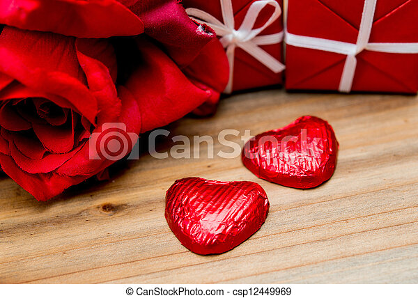 chocolate, gift box and flowers for Valentine's day - csp12449969
