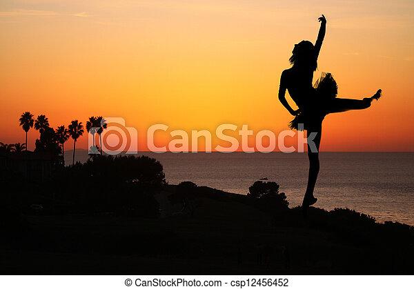 Ballet Dancer at Sunset Outdoors - csp12456452