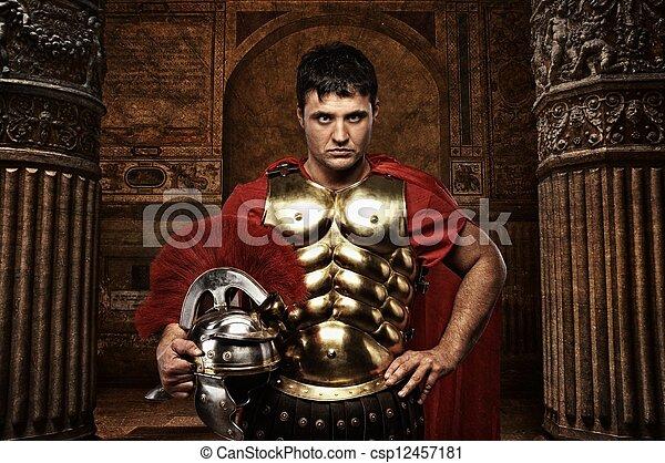 Roman soldier against antique building. - csp12457181