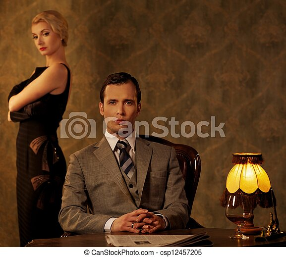 Man in suit  with woman behind him. - csp12457205