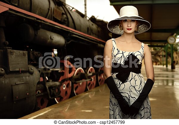Woman in hat on a train station - csp12457799