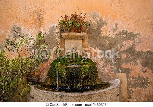 photo de boire fontaine mur csp12459325 recherchez des. Black Bedroom Furniture Sets. Home Design Ideas
