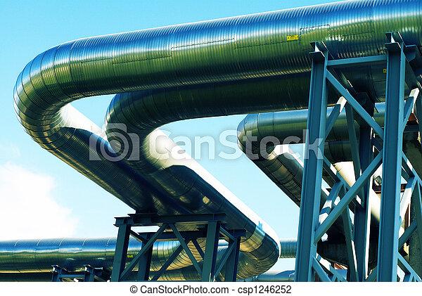 industrial pipelines on pipe-bridge against blue sky - csp1246252