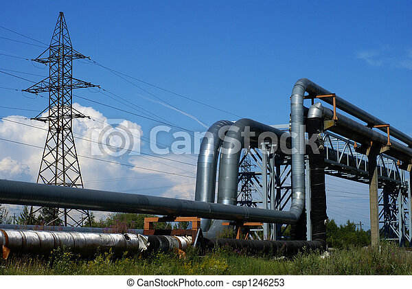 industrial pipelines on pipe-bridge and electric power lines against blue sky - csp1246253