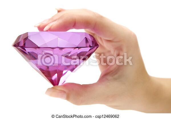 Holding a Pink Gemstone - csp12469062