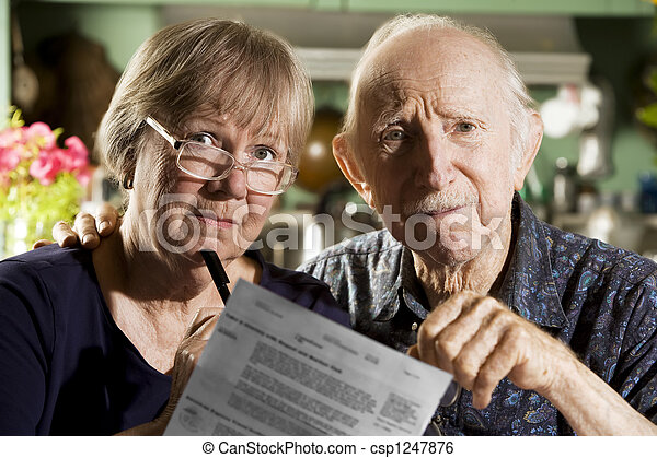 Elder Couple with Bills - csp1247876