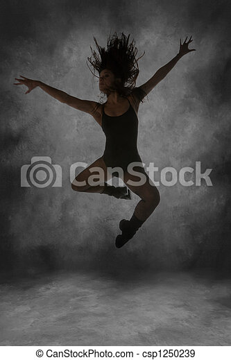 Young Street Dancer Leaping Mid Air