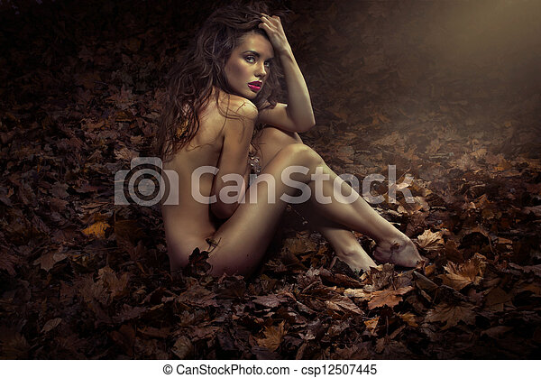 Naked pretty princess among leaves - csp12507445