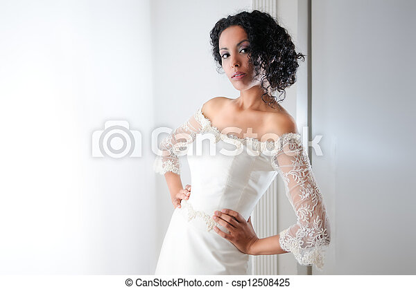 Young black woman, model of fashion, with wedding dress - csp12508425