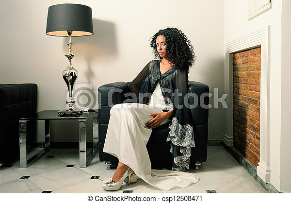 Young black woman, model of fashion, with party dress - csp12508471