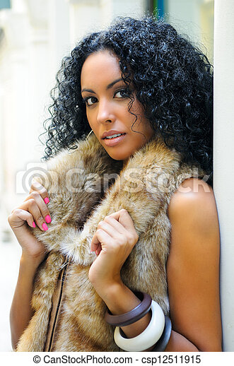 Young black woman, model of fashion, wearing fur vest - csp12511915
