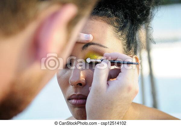 Professional makeup with a beautiful young black woman - csp12514102