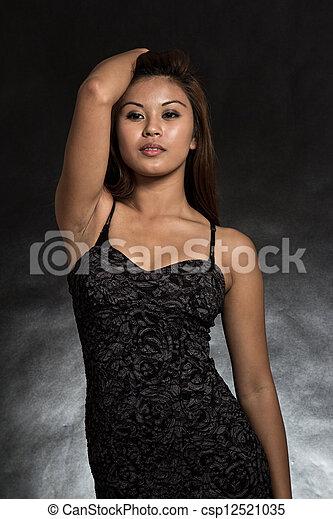 Young and beautiful filipino asian woman in black - csp12521035