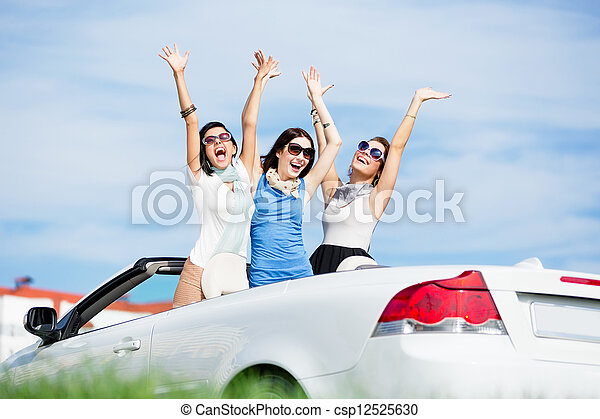 Friends stand in the automobile with hands up - csp12525630