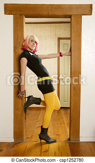 Stock Photography Of Woman Leaning Against A Door Jamb
