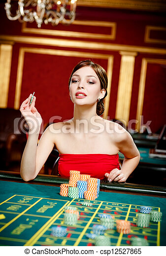 Girl gambles at the gambling house - csp12527865