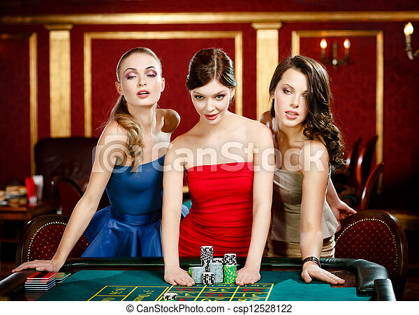 Three ladies place a bet playing roulette - csp12528122
