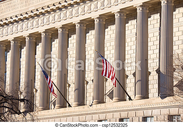 Flags Fly in Front of Government Building - csp12532325