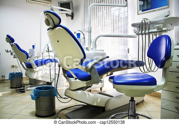 Dental office with two blue and white chairs - csp12550138