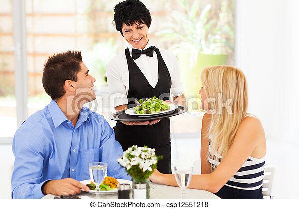 happy waitress serving customers - csp12551218