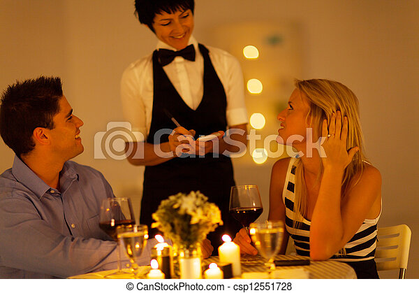 young couple place dinner order - csp12551728