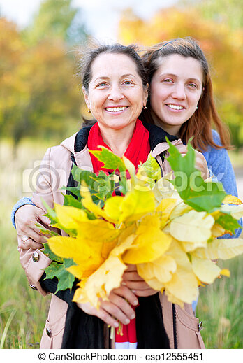 woman with adult daughter in autumn    - csp12555451