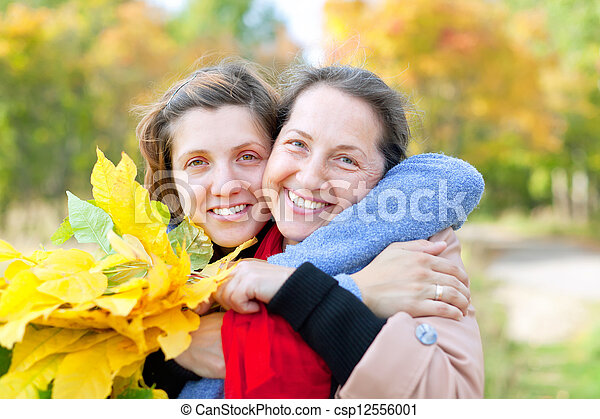 Happy  mature woman with adult daughter  - csp12556001