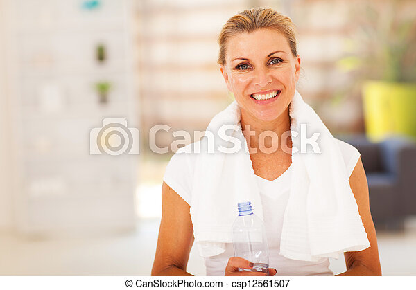 fitness senior woman with towel and water  - csp12561507