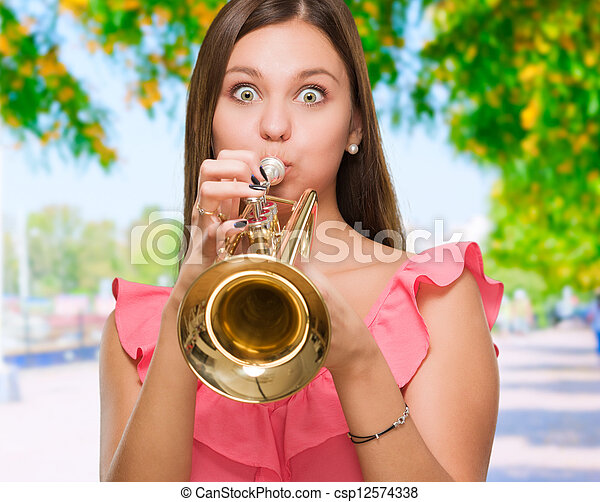 Young Woman Blowing Trumpet