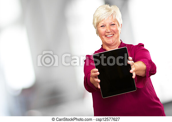Portrait Of A Senior Woman Holding A Laptop - csp12577627