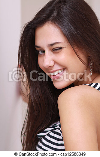 Portrait of young happy smiling woman - csp12586349