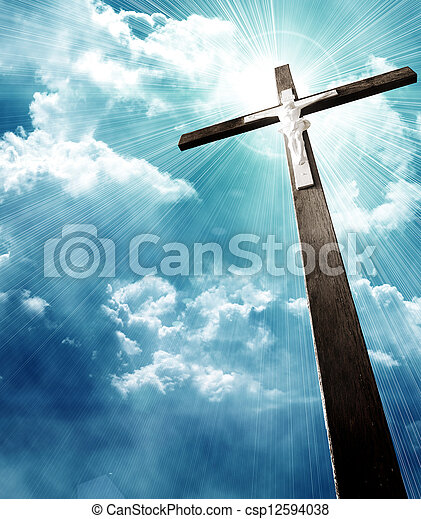 cross in sunrays against cloudy sky  - csp12594038