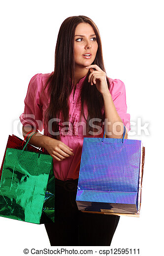 portrait of one happy young adult girl with colored bags - csp12595111