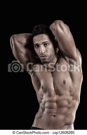 muscled man on a black background - csp12608285