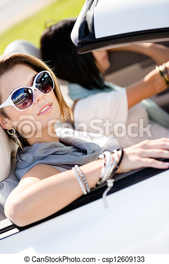 Close up of girls in sunglasses in the automobile - csp12609133