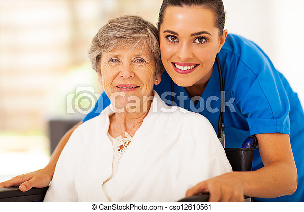 senior woman on wheelchair with caregiver - csp12610561