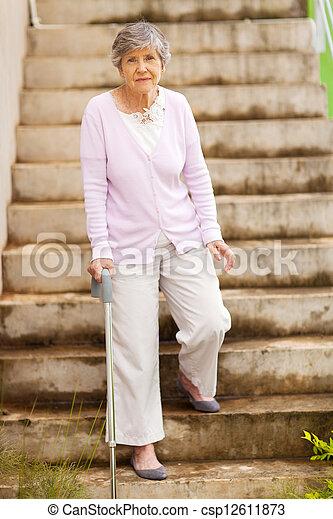 image de debout escalier femme solitaire personne agee csp12611873 recherchez des. Black Bedroom Furniture Sets. Home Design Ideas